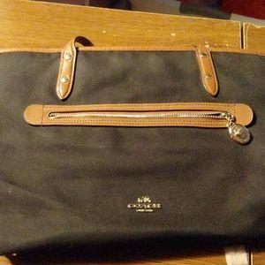 Black canvas coach purse